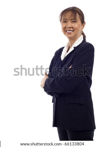 Asian American senior businesswoman standing with hands folded against white background - stock photo