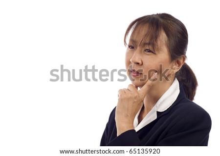 Asian American senior businesswoman thinking against white background - stock photo