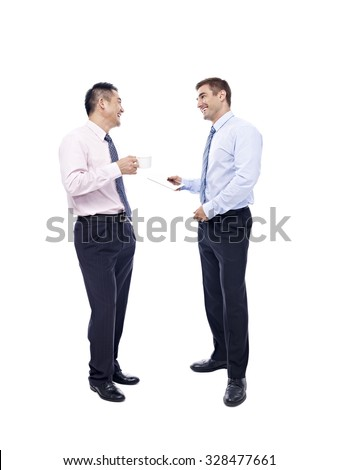 asian and caucasian business men having a discussion with coffee cup and tablet computer in hands, isolated on white background. - stock photo
