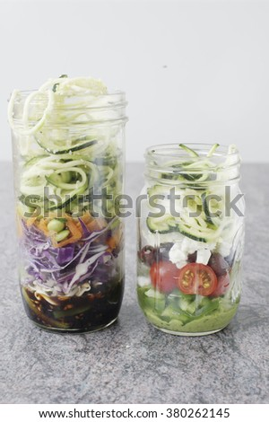 Asian and greek inspired mason jar salads with zucchini noodles (selective focus) - stock photo