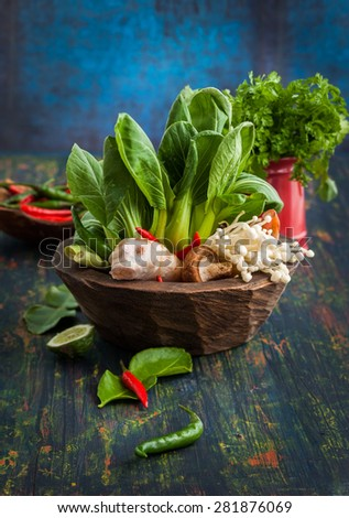 Asian assortment of fresh vegetables,mushrooms, spices and herbs - stock photo
