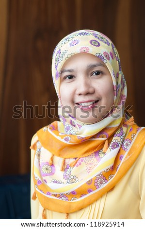 asian attractive Muslim female with yellow scarf