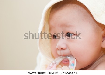 asian baby biting toys