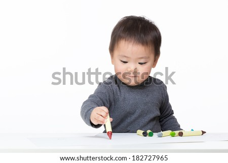 Asian baby boy concentrate on drawing - stock photo