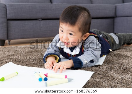 Asian baby boy drawing
