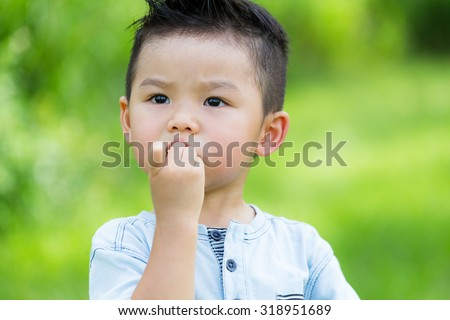Asian baby boy eat with finger food - stock photo