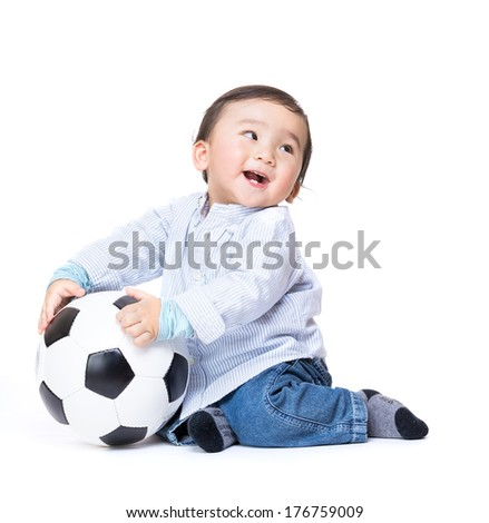 Asian baby boy feel excited playing soccer ball - stock photo