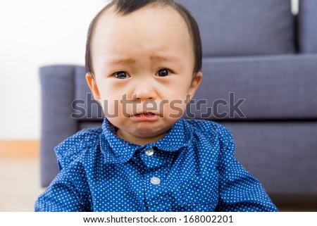 Asian baby boy feel sorrow - stock photo