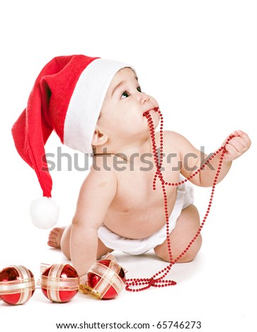 asian baby boy in a red christmas cap - stock photo