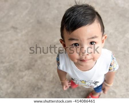 asian baby boy look up - stock photo