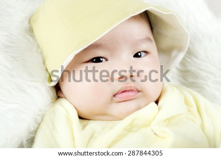 Asian baby boy lying on bed - stock photo