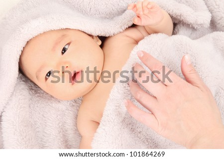 Asian baby boy lying on the blanket