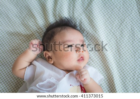 Asian baby boy newborn clench one's fists - stock photo
