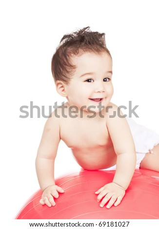 asian baby boy on a red ball - stock photo