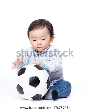 Asian baby boy play with football - stock photo