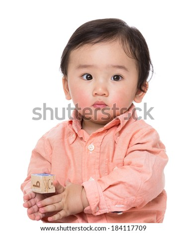 Asian baby boy play with wooden toy block - stock photo