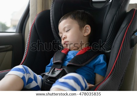 Asian baby boy sleeping in the carseat