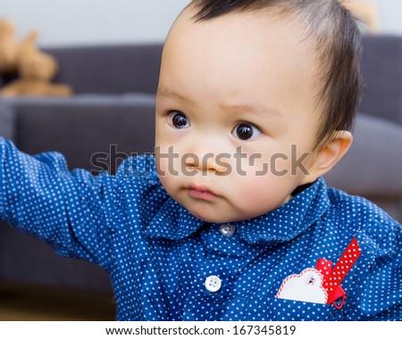 Asian baby boy staring at something - stock photo