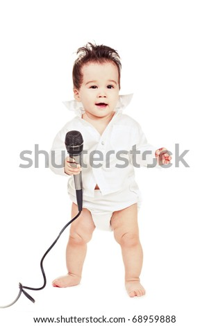 asian baby boy with microphone - stock photo