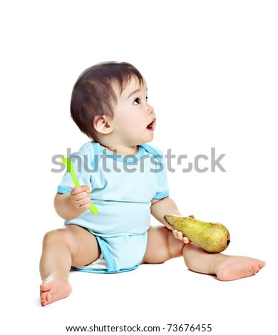asian baby boy with pear on a white background - stock photo