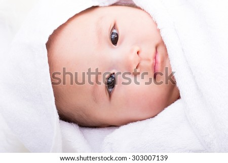 Asian baby face with white background. - stock photo