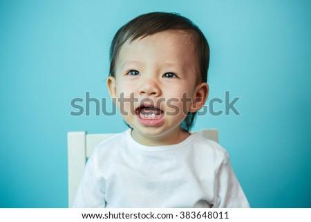 Asian baby girl crying, studio shot (soft focus on the eyes) - stock photo