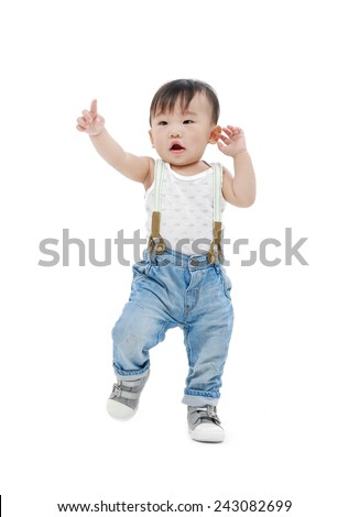 Asian baby girl finger point up-full body