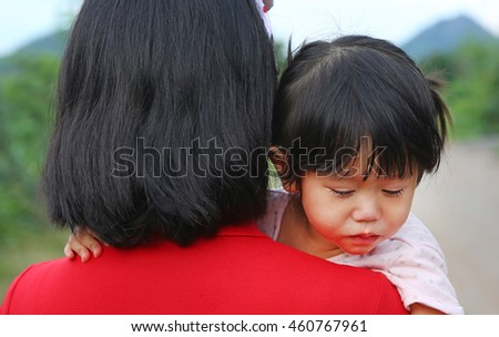 Asian baby girl hugging her mother crying
