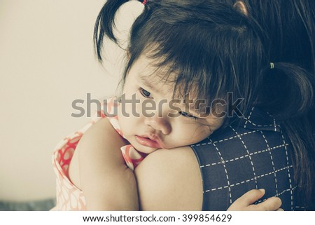 Asian baby girl hugging her mother crying in old vintage tone - stock photo