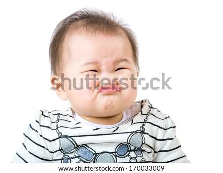 Asian baby girl make upset face - stock photo