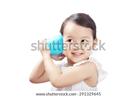 Asian Baby Girl Playing Blue Cup Phone. - stock photo