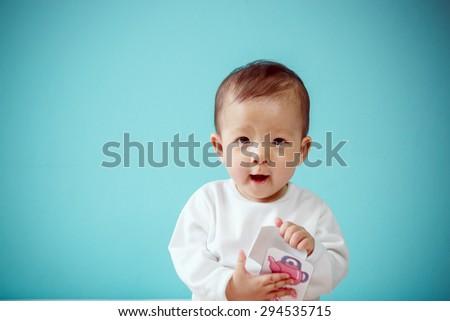 Asian Baby girl smiling, studio shot - stock photo