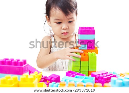 Asian Baby Girl, Toddler, Playing Colorful Blocks Isolated on White Background. - stock photo