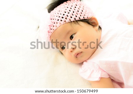 Asian baby  girl. Viewed from above