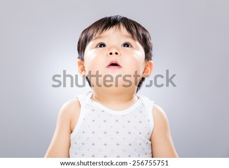 Asian baby looking up - stock photo