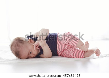 Asian baby,lying on the ground try turning