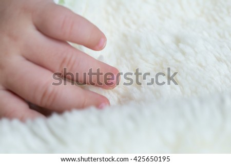 Asian baby sleeping on the bed with five finger - stock photo