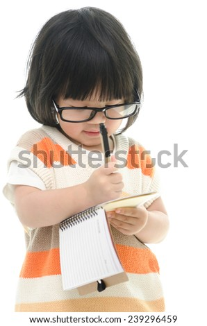 Asian baby standing and writing on white background isolated - stock photo