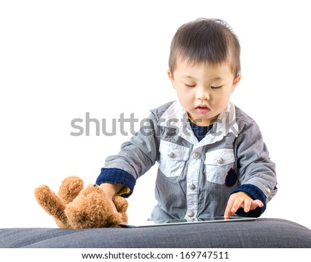 Asian baby touch the tablet