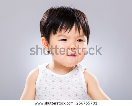 Asian baby with funny facial expression - stock photo