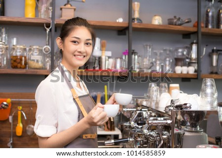 Asian Barista woman making Coffee with coffee machine in the coffee shop. people with barista in cafe concept.