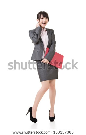 Asian beautiful businesswoman posing and holding a red clipboard while looking at the camera. Full length portrait. Isolated on the white background. - stock photo