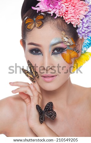 https://thumb7.shutterstock.com/display_pic_with_logo/1843625/210549205/stock-photo-asian-beautiful-girl-with-colorful-make-up-with-fresh-flowers-and-butterfly-beauty-face-head-and-210549205.jpg
