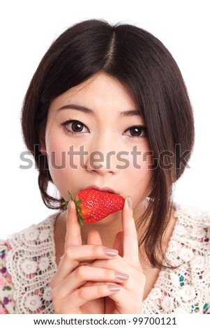 Asian beauty in eating strawberries