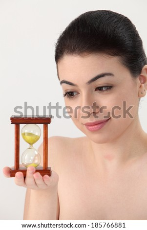 Asian beauty woman holding and looking at hourglass