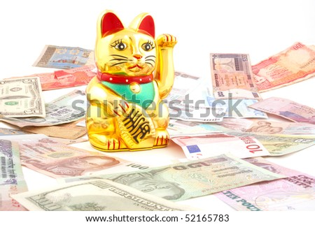 Asian beckoning cat meant to bring success in business - stock photo