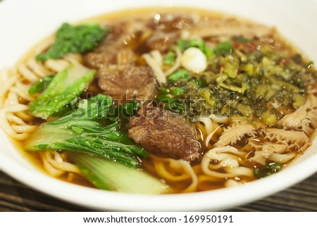 Asian beef noodles in soup - stock photo