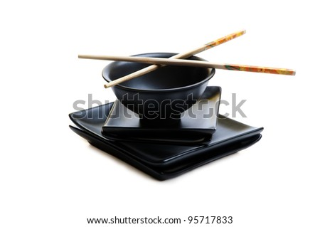 Asian black bowl, dishes and sticks isolated on white - stock photo