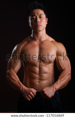 Asian Body Builder front muscles, biceps, abs, pecks - stock photo