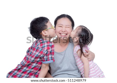 Asian boy and girl kissing their mother over white background
